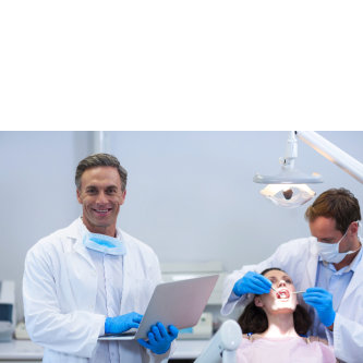 two dentists and woman in a dental care clinic