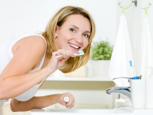 young woman going to brush her teeth